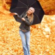 Beautiful female under umbrella - Stock Photo