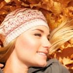 Pretty female on autumn background — Stock Photo #14031636