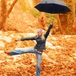 Sweet girl jumping with umbrella — Stock Photo #14031717