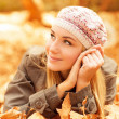 Royalty-Free Stock Photo: Cute female lay on fall leaves