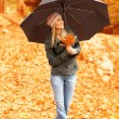 Stock Photo: Pretty woman under umbrella