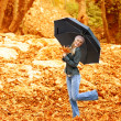 Happy female dancing with parasol — Stock Photo #14038758