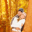 Happy couple in autumn woods — Stock Photo #14039181