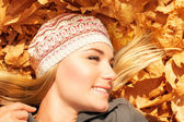 Pretty female on autumn background — Stock Photo