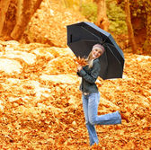 Happy female dancing with parasol — Stock Photo
