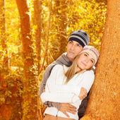 Happy couple in autumn woods — Stock Photo