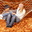 Stock Photo: Couple talking in hammock