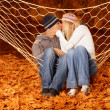 Loving pair kissing in hammock — Stock Photo #14043239