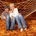 Happy family in hammock — Stock Photo