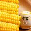 Sweetcorn with saltshaker - Stock Photo