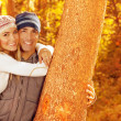 Happy couple in autumn park — Stok fotoğraf