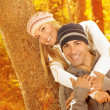 Stock Photo: Happy couple hugging in autumn park