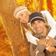 Happy couple hugging in autumn park — Stock Photo