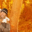 Young family in fall woods — Stock Photo