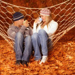 Stock Photo: Young couple drink tea in hammock