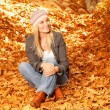 Happy girl in autumnal park - Stock Photo