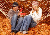 Birthday gift in autumn park — Stock Photo