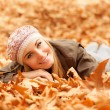 Woman lay on the ground - Stock Photo