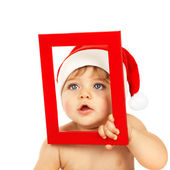 Cute child with red Christmas frame — Stock Photo