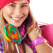 Young lady with colorful lollipop — Stock Photo