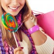 Woman eating sweet candy — Foto de Stock