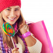 Stock Photo: Girl lick sweets and holding pink bag