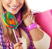 Woman eating sweet candy — Stock Photo