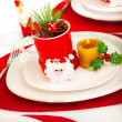 Christmastime table setting — Stock Photo