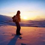 Woman traveler hiking in winter mountains — Stock Photo
