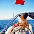 Man at the helm of yacht - Stock Photo