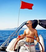 Man at the helm of yacht — Stock Photo