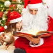 Little girl with Santa Claus — Foto Stock
