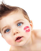 Kid with kiss — Stock Photo
