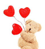 Teddy bear with red hearts — Stock Photo