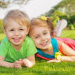 Brother and sister in the park — Stock Photo