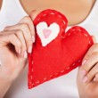 Red heart in hands — Stock Photo