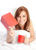 Happy female laying in the bed — Stock Photo