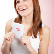 Girl with greeting card — Stock Photo