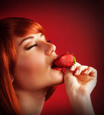 Seductive female with strawberry — Stok fotoğraf