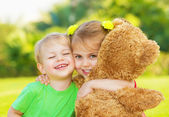 Two little child hugging — Stock Photo
