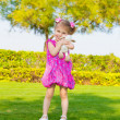 Little girl in spring park - Stock Photo