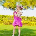 Little girl in spring park — Stock Photo #20590537