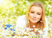 Female on chamomile meadow — Stock Photo