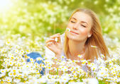 Woman in chamomile field — Stock Photo