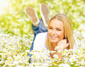 Female on chamomile field — Stock Photo