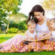Mother teaching her kids — Stock Photo