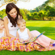 Mother with children read book — Photo
