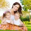 Mother with children read book — Foto Stock