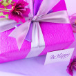 Pink gift box with flowers - Stock Photo