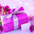 Gift box with pink flowers - Stock Photo